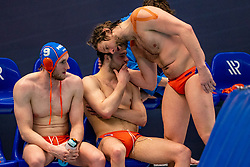Pascal Janssen, Jorn Muller, Thomas Lucas of the Netherlands disappointed against Montenegro during the Olympic qualifying tournament. The Dutch water polo players are on the hunt for a starting ticket for the Olympic Games on February 19, 2021 in Rotterdam