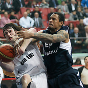 Efes Pilsen's Lawrence ROBERTS (2ndR) and Besiktas's Andrew James OGILVY (C) Serhat CETIN (L) during their Spor Toto Turkey Cup Basketball quarter final match Efes Pilsen between Besiktas at the Kadir Has Arena in Kayseri at Turkey on Wednesday, February, 09, 2011. Photo by TURKPIX