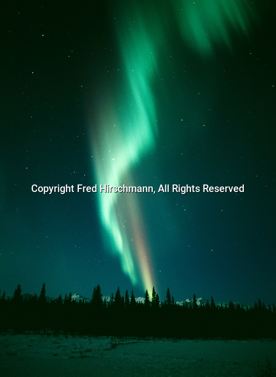 Green and red aurora over the Alaska Range during geomagnetic storm on the night of October 28, 2001, Broad Pass near Colorado, Alaska.