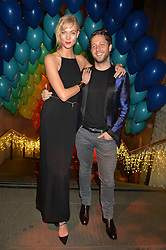 KARLIE KLOSS and DEREK BLASBERG at 'The World's First Fabulous Fund Fair' in aid of the Naked Heart Foundation hosted by Natalia Vodianova and Karlie Kloss at The Roundhouse, Chalk Farm Road, London on 24th February 2015.