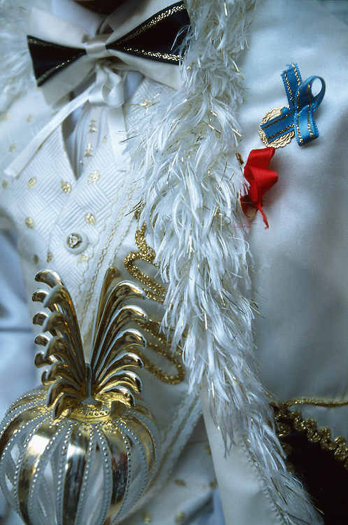 Details of the customary sultan outfit of a newly circumcised boy who lives in Istanbul, Turkey, includes bow-tie, sceptre and an embroidered cape adorned with a couple of gold conns to ward off the evil eye.