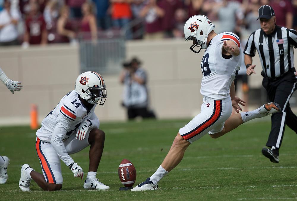 Auburn place kicker Daniel Carlson (38) kicks the ball to start an NCAA college football game against Texas A&M on Saturday, Nov. 4, 2017, in College Station, Texas. (AP Photo/Sam Craft)