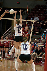 25 September 2004     Laura Doornbos spikes past Shari Vermeer.    Illinois State University Redbirds V University of Northern Iowa Panthers Volleyball.  Redbird Arena, Illinois State University, Normal IL