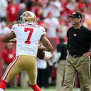 Head coach Jim Harbaugh and San Francisco 49ers quarterback Colin Kaepernick (7) are seen during an NFL football game between the San Francisco 49ers  and the Tampa Bay Buccaneers on Sunday, December 15, 2013 at Raymond James Stadium in Tampa, Florida.. (Photo/Alex Menendez)