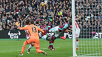 Football - 2016 / 2017 Premier League - West Ham United vs. Stoke City<br /> <br /> Cheikhou Kouyate of West Ham with an unorthodox clearance as the ball is driven across the West ham box <br /> at The London Stadium.<br /> <br /> COLORSPORT/DANIEL BEARHAM