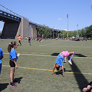 Players and staff relax between games during the 7th Annual AIG NYC Rugby Cup at Randall's Island, Manhattan, New York. USA. 7th June 2014. Photo Tim Clayton