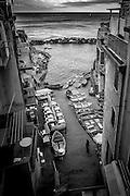 Riomaggiore fishing boats in port on the Cinque Terra, Italy