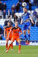 Cardiff City's Aron Gunnarsson (r) heads clear. Skybet football league championship match, Cardiff city v Ipswich Town at the Cardiff city stadium in Cardiff, South Wales on Saturday 12th March 2016.<br /> pic by Carl Robertson, Andrew Orchard sports photography.