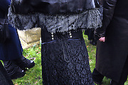 Details of a Vampyre Connexionís member during a tour to West Norwood Cemetery on Sunday, 4 March, 2007, in London, England. The Vampyre Connexion is the largest and most active of all the vampire groups in the United Kingdom, counting more than 100 members that for years have gathered regularly in London to share their common love for vampires and the Dark side of life. The Connexion raised from the hashes of the Vampyre Society, the first vampire appreciation group in 1995. The group believe in the fantasy of vampires and such creatures and live it to the full. Its  roots are to be found in the legends of Bram Stokerís Dracula. The group prints its own magazine, ëDark Nightsí featuring drawings, poetry, stories, photography and events. All of the members dress very peculiar clothing, and this is a very important part of the life of the group; it is respected with pride, taste and accuracy for the detail. Most like to dress to be elegant in a range of styles from regency to Victorian, some sew their own. In addition members visit art galleries, cemeteries, churches and cathedrals, attend gigs and concerts, and hold their own parties throughout the year, Halloween being the biggest and scariest one. Membership is open to all, the only qualification: being a love of all things Vampyric. **ItalyOut**
