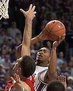 Kansas State guard Lance Harris (R) goes up for a shot against Nebraska's Aleks Maric (L) in the second half.  The Huskers defeated K-State 57-42 at Bramlage Coliseum in Manhattan, Kansas, January 11, 2006.