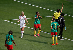 Match referee Qin Liang (second right) awards a free-kick to England in the penalty area after a back pass by Cameroon's Augustine Ejangue (5) during the FIFA Women's World Cup, round of Sixteen match at State du Hainaut, Valenciennes.