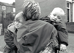 Mother with two small children, Nottingham UK 1995
