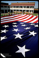 Sixth-graders hold famous 30'x 42' garrison flag @ parade ground in Fort McHenry; (v) Baltimore. Maryland