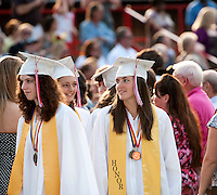 Graduates Brooke Baerman, Amy Cass and Emily Compton lead the processional onto the football field for the 133rd Commencement Exercise at Laconia High School Friday evening.  (Karen Bobotas/for the Laconia Daily Sun)Laconia High School commencement ceremony June 10, 2011.