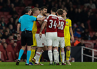 Football - 2018 / 2019 UEFA Europa League - Round of Thirty-Two, Second Leg: Arsenal (0) vs. BATE Borisov (1)<br /> <br />  Tempers flare towards the end after a poor challenge and Sokratis Papastathopoulos (Arsenal FC) pulss GranitXhaka (Arsenal FC) away at The Emirates.<br /> <br /> COLORSPORT/DANIEL BEARHAM