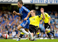 Photo: Daniel Hambury.<br />Chelsea v Manchester City. The Barclays Premiership. 20/08/2006.<br />Chelsea's Frank Lampard is tackled by  City's Richard Dunne.