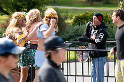 """An unidentified evangelist, with bullhorn, condemns the """"perverts"""" at the 107th running of the Bay to Breakers, Sunday, May 20, 2018, in San Francisco. (Photo by D. Ross Cameron)"""