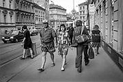 Residents walking Konevova street in Zizkov.