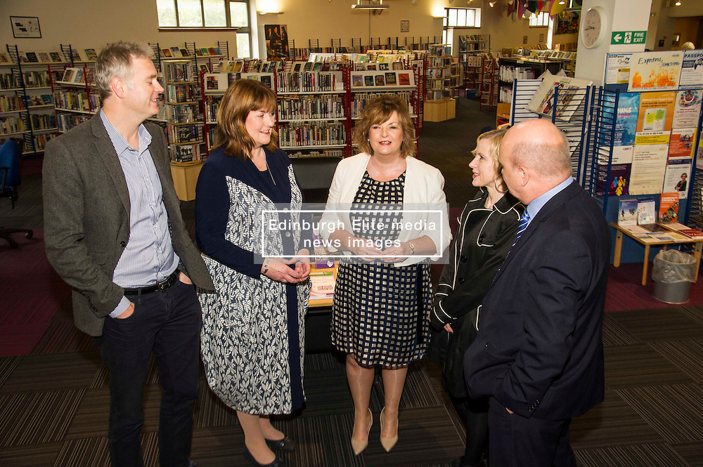 Pictured: Richard Lewis, Culture and Sport Convenor Edinburgh Council, Ms Hyslop , Pamela Tulloch, Chief Executive SLIC, Evelyn Kilmurray, Library and in formation manager and Gordon MacDonald, MSP chat at the announcement fo the additional funding.<br /> Culture Secretary Fiona Hyslop MSP visited Wester Hailes Library in Edinburgh today to meet primary-school pupils and Edinburgh City Council officials  to announce libraries support package<br /> <br /> Ger Harley | EEm 7 September 2016