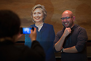 A guest takes a photo with a cardboard cutout of Hilary Clinton during the Dallas County Democratic watch party in Dallas, Texas on November 8, 2016. (Cooper Neill for The Texas Tribune)