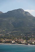 View of sea with harbor and mountain in background, Calvi, Corsica, France