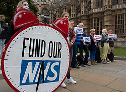 © Licensed to London News Pictures. 04/09/2021. London, UK. Protesters stand outside Parliament as they call for the government to tackle NHS waiting lists. Campaign group 'We Own It', are highlighting record waiting lists, which they say have been exacerbated by the pandemic, but are mostly due to privatisation and cuts. Photo credit: Peter Macdiarmid/LNP