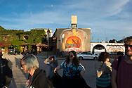 A tour group disembarks a small bus to visit a mezcal distillery called El Mitleno, located in San Pablo Villa de Mitla, Oaxaca state, Mexico. (November 3, 2014)