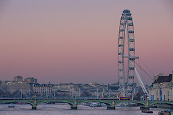 © Licensed to London News Pictures. 29/12/2016. London, UK. A deep pink sky is seen as the sun sets in central London after several days of freezing temperatures and heavy fog in the capital. Photo credit: Rob Pinney/LNP