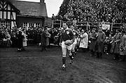 Irish team led by team Captain Dawson, enter the field, to play England,..Irish Rugby Football Union, Ireland v England, Five Nations, Landsdowne Road, Dublin, Ireland, Saturday 14th February, 1959,.14.2.1959, 2.14.1959,..Referee- D Gwynne Walters, Welsh Rugby Union, ..Score- Ireland 0 - 3 England, ..Irish Team, ..N J Henderson, Wearing number 15 Irish jersey, Full back, N.I.F.C, Rugby Football Club, Belfast, Northern Ireland,..N H Brophy, Wearing number 14 Irish jersey, Right wing, University College Dublin Rugby Football Club, Dublin, Ireland, ..A J O'Reilly, Wearing number 13 Irish jersey, Right Centre, Old Belvedere Rugby Football Club, Dublin, Ireland, and, Leicester Rugby Football Club, Leicester, England, ..J F Dooley, Wearing  Number 12 Irish jersey, Left Centre, Galwegians Rugby Football Club, Galway, Ireland, ..A C Pedlow, Wearing number 11 Irish jersey, Left wing,  C I Y M S Rugby Football Club, Belfast, Northern Ireland, ..M A English, Wearing number 10 Irish jersey, Outside Half, Bohemians Rugby Football Club, Limerick, Ireland,..A A Mulligan, Wearing number 9 Irish jersey, Scrum Half, London Irish Rugby Football Club, Surrey, England, ..B G Wood, Wearing number 1 Irish jersey, Forward, Garryowen Rugby Football Club, Limerick, Ireland, ..A R Dawson, Wearing number 2 Irish jersey, Captain of the Irish team, Forward, Wanderers Rugby Football Club, Dublin, Ireland, ..S Millar, Wearing number 3 Irish jersey, Forward, Ballymena Rugby Football Club, Antrim, Northern Ireland,..W A Mulcahy, Wearing number 4 Irish jersey, Forward, University College Dublin Rugby Football Club, Dublin, Ireland, ..M G Culliton, Wearing number 5 Irish jersey, Forward, Wanderers Rugby Football Club, Dublin, Ireland, ..N A Murphy, Wearing number 6 Irish jersey, Forward, Cork Constitution Rugby Football Club, Cork, Ireland,..P J A O' Sullivan, Wearing  Number 7 Irish jersey, Forward, Galwegians Rugby Football Club, Galway, Ireland,..J R Kavanagh, Wearing number 8 Irish jersey, Forward
