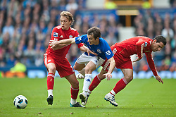 17.10.2010, Goodison Park, Liverpool, ENG, PL, Everton FC vs Liverpool FC, im Bild Liverpool's Lucas Leiva and Maximiliano Ruben Maxi Rodriguez and Everton's Leighton Baines during the 214th Merseyside Derby match at Goodison Park, EXPA Pictures © 2010, PhotoCredit: EXPA/ Propaganda/ Chris Brunskill *** ATTENTION *** UK OUT!