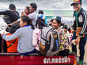 09 JULY 2014 - ARANYAPRATHET, SA KAEO, THAILAND:  Cambodian migrants arrive at the immigration station in Aranyaprathet in a  Thai police truck. The Thai government has opened a One Stop Service Center in Aranyaprathet on the Thai-Cambodian border. More than 200,000 Cambodian migrant workers, most undocumented, fled Thailand in early June fearing a crackdown by Thai authorities after a coup unseated the elected government. Employers have been unable to fill the vacancies created by the Cambodian exodus and the Thai government has allowed them to return. The Cambodian workers have to have a job and their employers have to vouch for them. The Thai government is issuing temporary ID cards to allow them to travel openly to their jobs. About 800 Cambodian workers came back to Thailand through the Aranyaprathet border crossing Wednesday. The Thai government has opening similar service centers at three other crossing points on the Thai-Cambodian border.   PHOTO BY JACK KURTZ