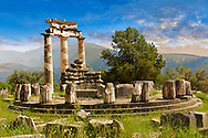 The circular Delphi Tholos temple with Doric columns, 380 BC, Sanctuary of Athena Pronaia, Delphi Archaeological Site,  Greece .<br /> <br /> If you prefer to buy from our ALAMY PHOTO LIBRARY  Collection visit : https://www.alamy.com/portfolio/paul-williams-funkystock/delphi-site-greece.html  to refine search type subject etc into the LOWER SEARCH WITHIN GALLERY.<br /> <br /> Visit our ANCIENT GREEKS PHOTO COLLECTIONS for more photos to download or buy as wall art prints https://funkystock.photoshelter.com/gallery-collection/Ancient-Greeks-Art-Artefacts-Antiquities-Historic-Sites/C00004CnMmq_Xllw