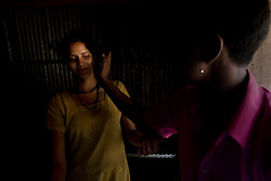Sex worker Shetu, 17, is harassed by a customer at brothel in Tangail, Bangladesh.