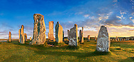 Panorama of Calanais Standing Stones  central stone circle erected between 2900-2600BC measuring 11 metres wide. At the centre of the ring stands a huge monolith stone 4.8 metres high weighing about 7 tonnes, which is perfectly orientated so that its widest sides face due north south. Calanais Neolithic Standing Stone (Tursachan Chalanais) , Isle of Lewis, Outer Hebrides, Scotland. .<br /> <br /> Visit our SCOTLAND HISTORIC PLACXES PHOTO COLLECTIONS for more photos to download or buy as wall art prints https://funkystock.photoshelter.com/gallery-collection/Images-of-Scotland-Scotish-Historic-Places-Pictures-Photos/C0000eJg00xiv_iQ<br /> '<br /> Visit our PREHISTORIC PLACES PHOTO COLLECTIONS for more  photos to download or buy as prints https://funkystock.photoshelter.com/gallery-collection/Prehistoric-Neolithic-Sites-Art-Artefacts-Pictures-Photos/C0000tfxw63zrUT4