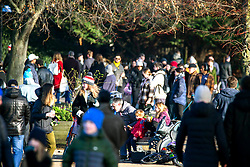 © Licensed to London News Pictures.09/01/2021, London, UK. Members of the public enjoy a walk through Victoria Park in east London during a third national Lockdown. London Mayor Sadiq Khan has declared a Covid-19 emergency in London as capital's hospitals struggle to cope with number of patients. Photo credit: Marcin Nowak/LNP