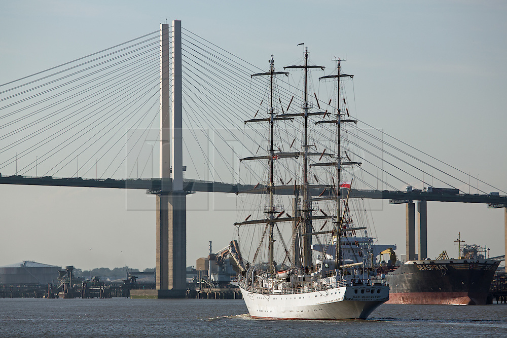 © Licensed to London News Pictures. 03/09/2014. Approaching the QEII Bridge. The huge tall ship Dar Mlodziezy arrived in London the evening of September 3rd in readiness for this weekend's Royal Greenwich Tall Ships Festival. Reckoned to be the largest tall ship on the Thames for 25 years, the 108-metre-long Class A ship arrived in London shortly before sunset. She will be joined by approximately 50 other ships for the regatta this weekend which is expected to draw over a million people. All of the ships will leave in a Parade of Sail on September 9th. It is the biggest Tall Ships event on the Thames since the Tall Ships Race of 1989. Credit : Rob Powell/LNP
