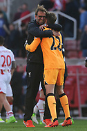 Liverpool goalkeeper Simon Mignolet is hugged by Liverpool manager Jurgen Klopp after the final whistle. Premier league match, Stoke City v Liverpool at the Bet365 Stadium in Stoke on Trent, Staffs on Saturday 8th April 2017.<br /> pic by Bradley Collyer, Andrew Orchard sports photography.