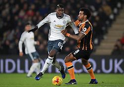 Manchester United's Paul Pogba (left) and Hull City's Tom Huddlestone battle for the ball