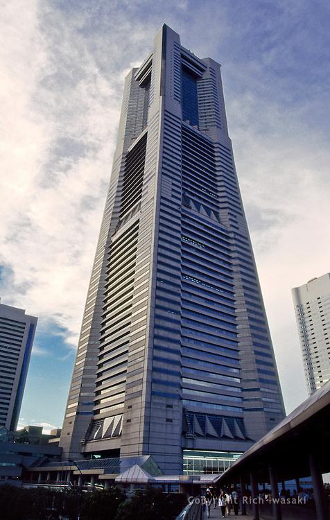 Low angle view of Yokohama Landmark Tower, Minato Mirai 21 district, Yokohama, Kanagawa Prefecture, Japan. The tower is the tallest building in Japan, standing 295.8 m (970 ft) high.