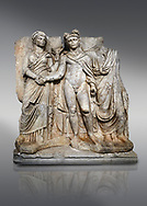 """Roman Sebasteion releif sculpture of emperor Claudius and Agrippina, Aphrodisias Museum, Aphrodisias, Turkey. <br /> <br /> Claudius in heroic nudity and military cloak shakes hands with his wife Agrippina and is crowned by the Roman people or the Senate wearing a toga. The subject is imperial concord with the traditional Roman state. Agrippina holds ears of wheat: like Demeter goddess of fertility. The emperor is crowned with an oak wreath, the Corona civica or """"citizen crow"""", awarded to Roman leaders for saving citizens lives: the emperor id therefore represented as saviour of the people. .<br /> <br /> If you prefer to buy from our ALAMY STOCK LIBRARY page at https://www.alamy.com/portfolio/paul-williams-funkystock/greco-roman-sculptures.html . Type -    Aphrodisias     - into LOWER SEARCH WITHIN GALLERY box - Refine search by adding a subject, place, background colour, museum etc.<br /> <br /> Visit our ROMAN WORLD PHOTO COLLECTIONS for more photos to download or buy as wall art prints https://funkystock.photoshelter.com/gallery-collection/The-Romans-Art-Artefacts-Antiquities-Historic-Sites-Pictures-Images/C0000r2uLJJo9_s0"""