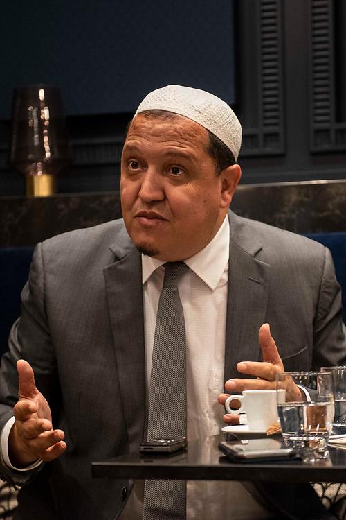 Hassen Chalghoumi (born Tunis, 1972), talks with members of the press in the café Grand Corona in Paris. Chalghoumi is the imam of the mosque in Drancy, in the 93, Seine-Saint-Denis, department near Paris. He presents himself as a moderate Iman, open for dialogue with the Jewish community and the French State. Paris, France, October 20, 2020. <br /> Hassen Chalghoumi (né à Tunis, 1972) en discussion avec la presse dans le café Grand Corona à Paris. Chalghoumi est l'imam de la mosquée de Drancy, dans le 93, département de la Seine-Saint-Denis, près de Paris. Il se présente comme un Iman modéré, ouvert au dialogue avec la communauté juive et l'Etat français. Paris, France, 20 octobre 2020.