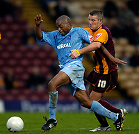 Photo: Jed Wee.<br />Bradford City v Tranmere Rovers. The FA Cup.<br />06/11/2005.<br /><br />Tranmere's Mark Rankine (L) tries to get away from Bradford's Dean Windass.