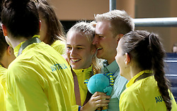 Australia's Nicole Seekamp (centre) gets engaged after receiving her gold medal in the Women's Gold Medal Game at the Gold Coast Convention and Exhibition Centre during day ten of the 2018 Commonwealth Games in the Gold Coast, Australia.