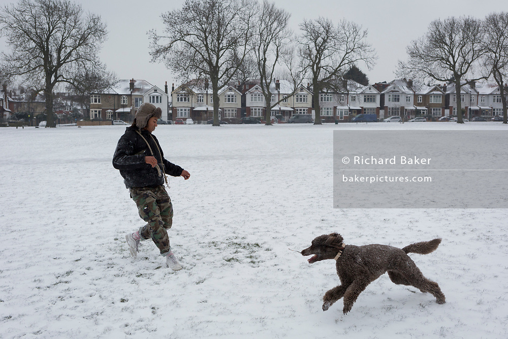 A pet dog plays in the snow in Ruskin Park, south London during the bad weather covering every part of the UK and known as the 'Beast from the East' because Siberian winds and very low temperatures have blown across western Europe from Russia, on 1st March 2018, in Lambeth, London, England.