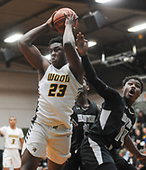 Archbishop Wood's Robert Jackson #23 fights for a loose ball with Strath Haven's Isaiah Freeman #14 in the first quarter of the Strath Haven vs Archbishop Wood PIAA State Playoff  Friday, March 06, 2020 at Bonner Prendergast High School in Drexel Hill, Pennsylvania. (WILLIAM THOMAS CAIN/PHOTOJOURNALIST)