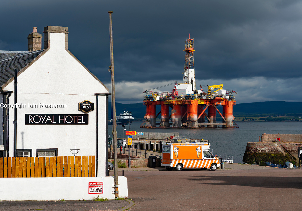 Royal Hotel and moored oil rig at Cromarty village on Black Isle on Cromarty Firth, Ross and Cromarty, Scotland, UK