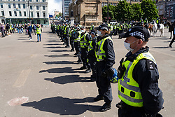 Glasgow, Scotland, UK. 20 June, 2020. Anti facist and pro refugee demonstration and protest today in George Square, Glasgow. Large police and mounted police presence all around the square. Loyalist group guarding war memorial were surrounded by cordon of police.   Iain Masterton/Alamy Live News