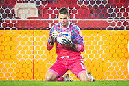 Middlesbrough goalkeeper Marcus Bettinelli (1) makes a save during the EFL Sky Bet Championship match between Brentford and Middlesbrough at Brentford Community Stadium, Brentford, England on 7 November 2020.
