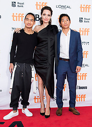 """Left to right, Maddox Jolie-Pitt, Angelina Jolie and Pax Jolie-Pitt pose for photographs on the red carpet for the movie """"First They Killed My Father"""" during the 2017 Toronto International Film Festival in Toronto, ON, Canada, on Monday, September 11, 2017. Photo by Nathan Denette/CP/ABACAPRESS.COM"""