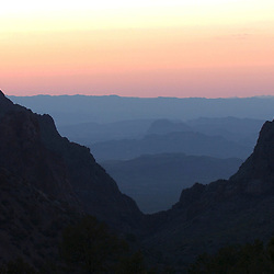 """Sunset view through """"The Window"""" looking out from The Basin area in the Chisos Mountains of Big Bend National Park in ar west Texas.<br /> ©Bob Daemmrich"""